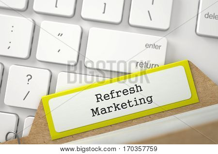 Refresh Marketing written on Yellow Folder Register Overlies White Modern Keypad. Close Up View. Selective Focus. 3D Rendering.