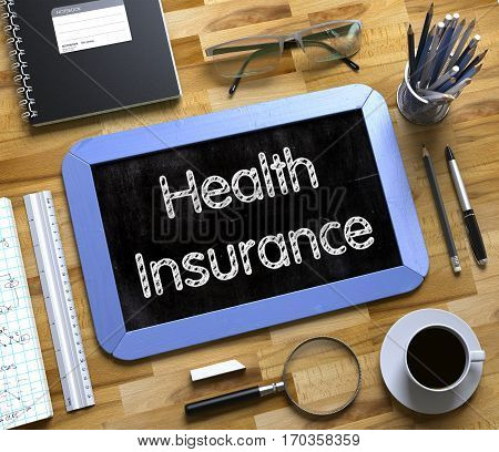 Health Insurance Handwritten on Small Chalkboard. Blue Small Chalkboard with Handwritten Business Concept - Health Insurance - on Office Desk and Other Office Supplies Around. Top View. 3d Rendering.