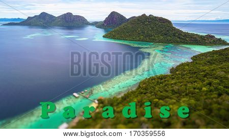 Paradise quote concept with Tropical paradise island with bright smooth mirror sand & crystal clear water with rocky shore in the island of Semporna, Borneo, ideal for print card and poster design.
