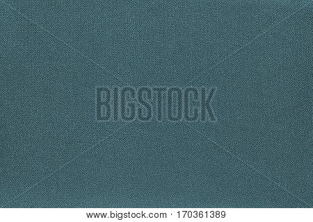 abstract speckled texture and background of textile material or fabric of dark turquoise color