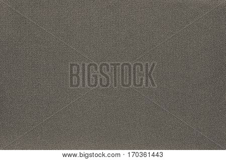 abstract speckled texture and background of textile material or fabric of dark beige color
