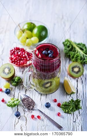 Green and red smoothie with chia and kale superfoods detox vitamin vegan drink