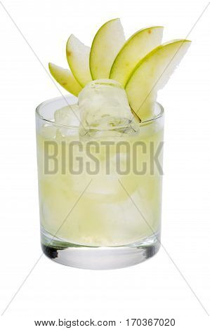 White lemonade with apple slices and big ie cubes in the glass close-up on the white background