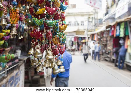 gifts display at shopfront and blur background of marketplace in Pushkar city Rajasthan India.