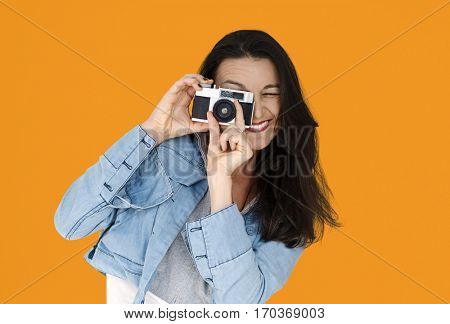 A woman using camera to capture