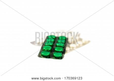 Pills in blisters isolated on a white background