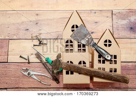 Hammer and tools for repair and construction of a wooden background and Cortona volume houses. Concept of repair and construc