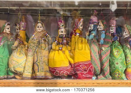 india style tribe dolls in showcase display of shopfront in Pushkar city rajasthan India