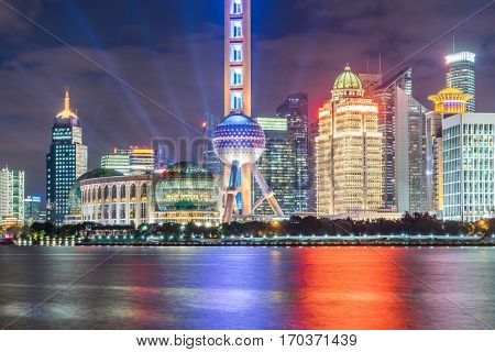 Landmarks of Shanghai with Huangpu river at night in China.
