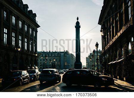 PARIS, FRANCE - CIRCA DECEMBER 2016: View on Place Vendôme and its backlit column from rue de la Paix.