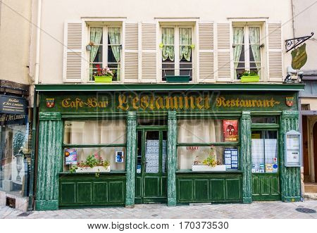 CHARTRES, FRANCE - CIRCA DECEMBER 2016: Facade of l'Estaminet, cafe-bar and restaurant in Chartres historical centre.