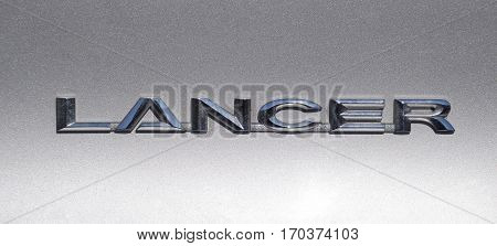 Lancer inscription on a silver background. Relief letters.