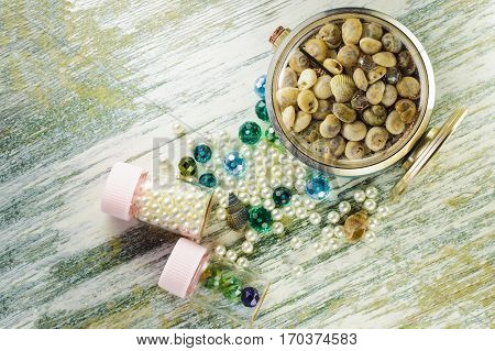 Blue Beads, Pearl And Clock With Seashells And Jars With Pearls.