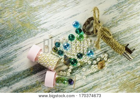 Blue Beads, Pearl, Old Key And Jars With Pearls.