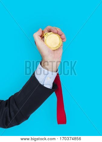 Business Attire Hand Holding Medal