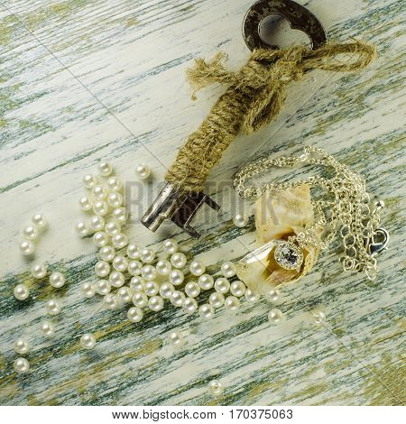 Pendant In Seashell And Old Key Among Scattered Pearls.