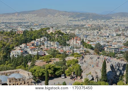 ATHENS, GREECE - OCTOBER 18: Tourists visit the Areopagus rock in front of Acropolis of Athens in the city center OCTOBER 18, 2014 in Athens, Greece