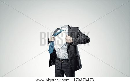 Headless businessman in black suit acting like super hero