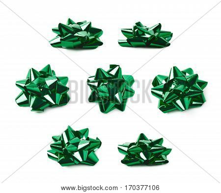 Decorational bow made of glossy green tape, composition isolated over the white background, set of seven different foreshortenings