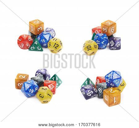 Pile of colorful roleplaying polyhedral dices isolated over the white background, set of four different foreshortenings