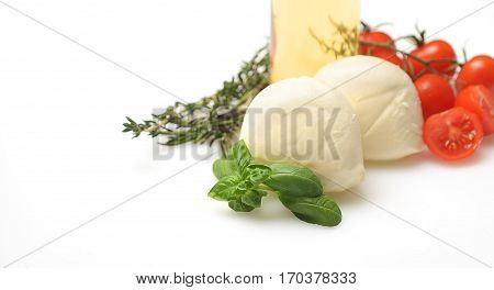 Mozzarella with cherry tomatoes,oil and basil on white background