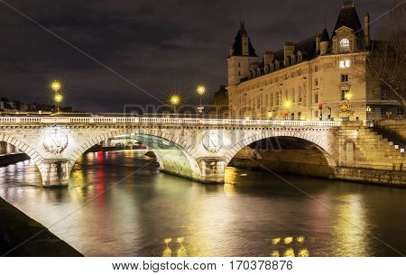 The pont Saint- Michel is a bridge linking the Place Saint-Michel on the left bank of the river Seine to the Ile de la Cite in Paris France. The present 62-meter-long bridge dates to 1857.
