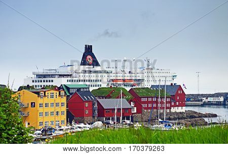 Torshavn, Faroe Islands - June 5, 2014: The ferry ship Norröna from Smyril Line has moored in Torshavn.