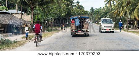 Zanzibar, Tanzania - July 14, 2016: Trucks and bicycles on the streets of Zanzibar, Tanzania, poor life of local people