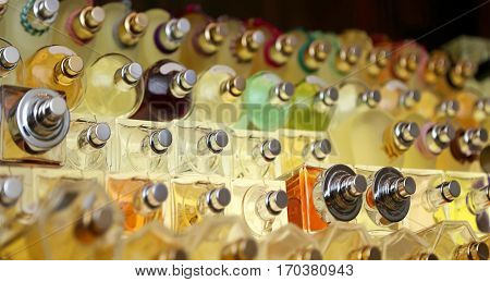 many perfume bottles in the company that makes perfumes and fragrances for men and women