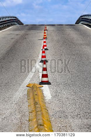 overpass without cars with traffic cones to mark lanes
