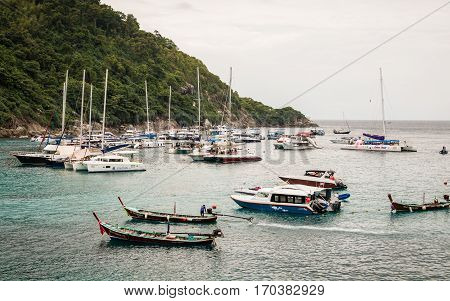 PHUKET THAILAND - FEB 01 : Many boat in raya island Which is one of the most famous tourist attraction on February 01 2017. Phuket Thailand