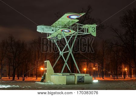 Gatchina Russia - February 10 2016: Monument in honor of the 100th anniversary of the first military airport in Russia. Airplane Model Foreman. Night Photography. Side view.