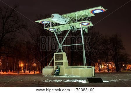 Gatchina Russia - February 10 2016: Monument in honor of the 100th anniversary of the first military airport in Russia. Airplane Model Foreman. Night Photography.