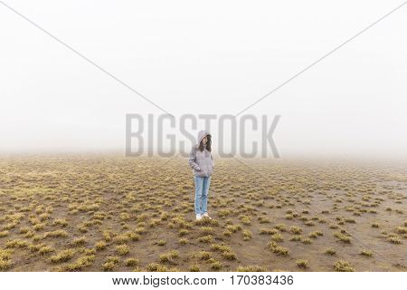 Woman in marsh at winter