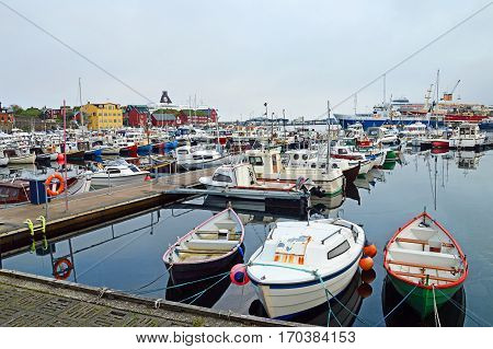Torshavn, Faroe Islands - June 05, 2014: Trawler and pleasure boats in the port of Torshavn in the Faroe Islands.