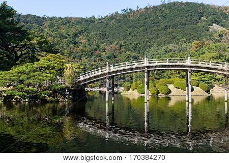 Traditional Ritsurin Garden and wooden bridge