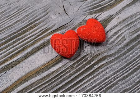 Heart on a wooden background with snow. Valentines day. Valentines day greeting card.