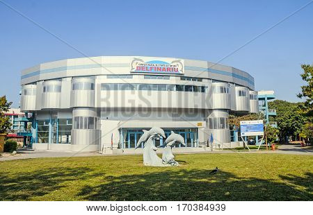 Constanta, Romania - September 15, 2016: The Dolphinarium Building With Dolphins Statue In Front