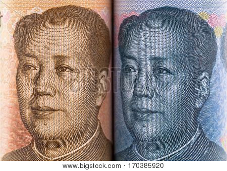 Closeup facial part of Chinese yuan banknotes with face of Mao Tse-tung