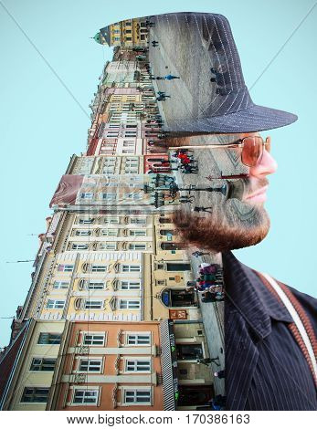 Street and buildings in the background of a person's face. Double exposure