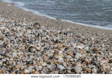 Sea line in a pebbled beach in Greece