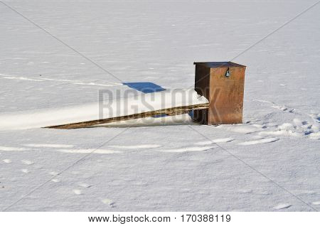 equipment for draining water from the lakes frozen in ice south Bohemia Czech Republic