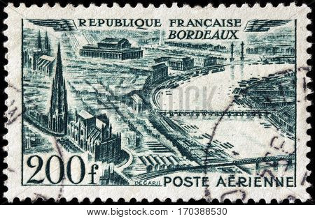 LUGA RUSSIA - FEBRUARY 7 2017: A stamp printed by FRANCE shows bird's-eye view of Bordeaux - a port city on the Garonne River in the Gironde department in southwestern France circa 1949