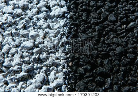 New asphalt texture with white dashed line.