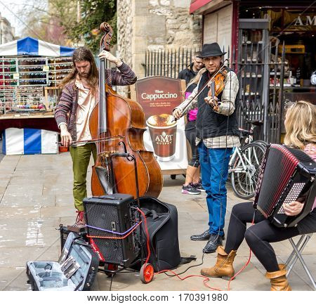 Oxford UK - May 1 2016: Street musicians performing in a commercial street of Oxford