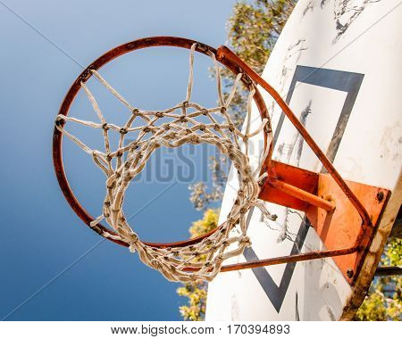 Looking up through Basket ball hoop to the sky