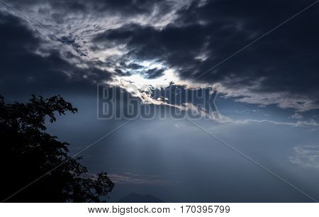sun backside dark clouds silhouette natural background