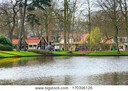 Lisse, Netherlands - April 4, 2016: Lake and park entrance in the spring flower garden Keukenhof