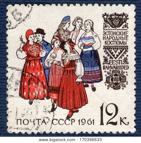 USSR - CIRCA 1961: Postage stamp printed in the USSR  with a picture women and a man in estonian folk costumes,  from the series