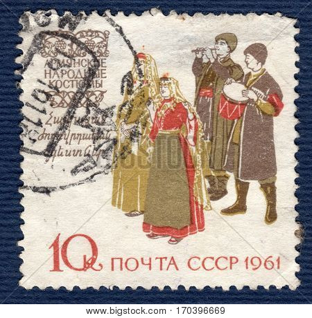 USSR - CIRCA 1961: Postage stamp printed in USSR shows image of musicians and dancers in Armenia traditional and historic regional costumes, from the series